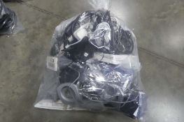 Bag containing a wide variety of IT components, remote controls, network cabling, AV cables, etc