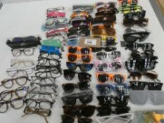 Bag containing quantity of sunglasses and reading glasses