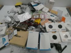 Bag containing large quantity of mobile phone accessories; earphones, leads, wireless chargers,