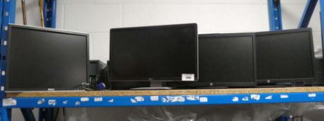 4 LCD PC monitors to include 2 by HP and 2 by Dell