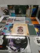 Box containing LP and 45 records to include Motorhead, Lana Del Ray, Bob Dylan and others