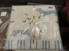 Emily Bond throw in cream and blue