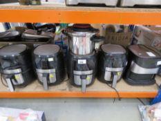 5 unboxed Gourmet fryers plus a Tefal pressure cooker