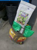 Quantity of black plastic pots, slug deterrent, and multi purpose compost