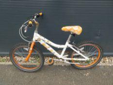 Orange and white childs bike
