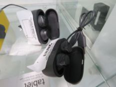 2 loose sets of Jabra Active earphones with charging cases