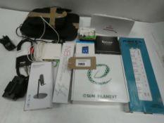 Bag containing routers, 3D printer filament, Pibee P42U 4-power socket, audio cable