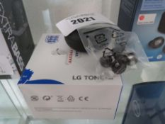 2 UV Nano tone free earbuds by LG (one boxed, one unboxed)