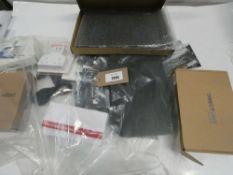 Bag containing router, laptop cooling stand, decoy CCTV, 3D printer filament, etc