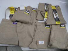 Bag of Kirkland Signature men's 5-pocket brushed cotton twill pants in khaki in various sizes