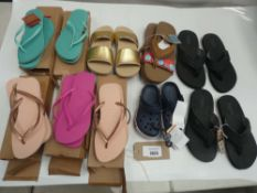 Bag of sandals and flip flops to include Flojos, Crocs and Havaianas in various sizes