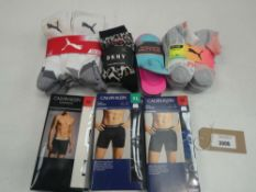 Bag of Calvin Klein underwear and mixed paired socks to include DKNY, Puma and Sketchers