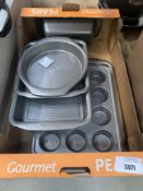 Tray containing bakeware tins