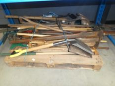 Pallet of assorted garden tools including hose, spades, shovels, rakes, forks, etc