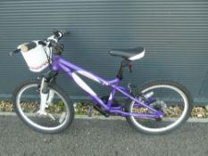Purple Carrera small girls bike with front basket