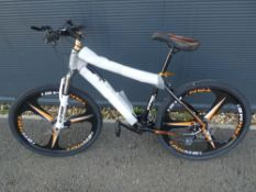 Extreme black and orange gents mountain bike