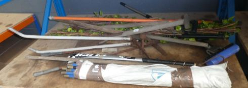 Shelf containing small quantity of garden tools, screening and drain rods