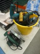 Bucket of assorted drills and Bosch circular saw