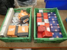 2 green plastic boxes of Hilti and Spit nails