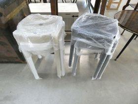 Four assorted plastic stools