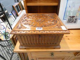 Heavily carved cutlery box in oak