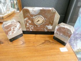 Mantelpiece clock in black and brown marble and two garnitures