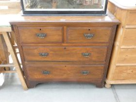 Dark wood two over two chest of drawers