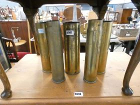 (5) Five shell cases