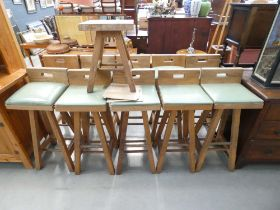 Ten oak based bar stools with green rexine seat and one matching low stool