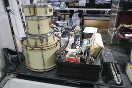 Carton drumset pieces together with various kit pedals, stands and other drum accessories