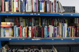 Large shelf comprising various hardback and paperback novels, autobiographies, etc