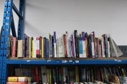 Part shelf containing various reference material books and other study materials, publishers include