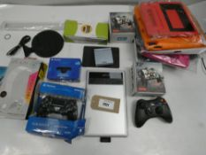 Bag containing Nintendo Gameboy SP, controllers, hard drive for Xbox 360, headset stand, graphic