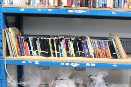 Shelf containing various Penguin books, childrens stories and other novels