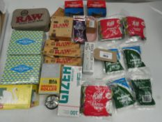 Bag containing various smoking accessories; filters, papers, ash trays, cigarette maker, etc