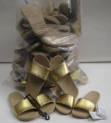 Bag containing approx 24 pairs of Crocs ladies sliders in beige with gold band