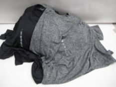 Bag containing approx 18 Under Armour t shirts mainly in black and a few in speckled grey sizes