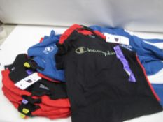 Bag containing approx 15 twin pack sets of children's t shirts by Champion colours to inc. red,
