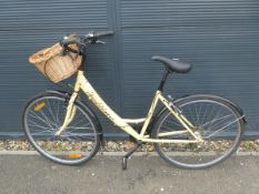 Traditional step through bike in cream with shopping basket