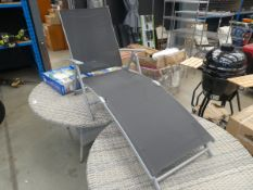 Garden recliner with black mesh seating on grey supports