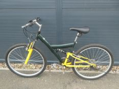 Full suspension mountain bike in yellow and green