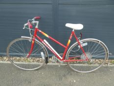 Peugeot bike in red and yellow