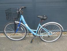 Metis step through bike in blue with shopping basket