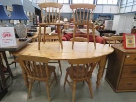5410 Striped pine oval dining table together with 6 spindle back dining chairs