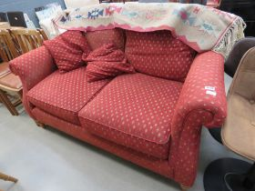 Red 2 seater sofa with diamond decoration