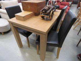 Oak veneer dining table together with 4 leatherette chairs