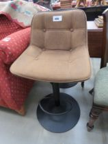 Tan button upholstered bar stool