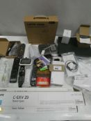Bag containing Cisco switch, laptop stand, remote controls, aerials, guitar strings, Canon toner (