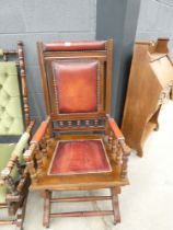 Mahogany and red tooled leather rocking chair