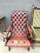 Burgundy and button upholstered fireside armchair